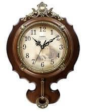 Часы настенные с маятником в деревянном корпусе фото